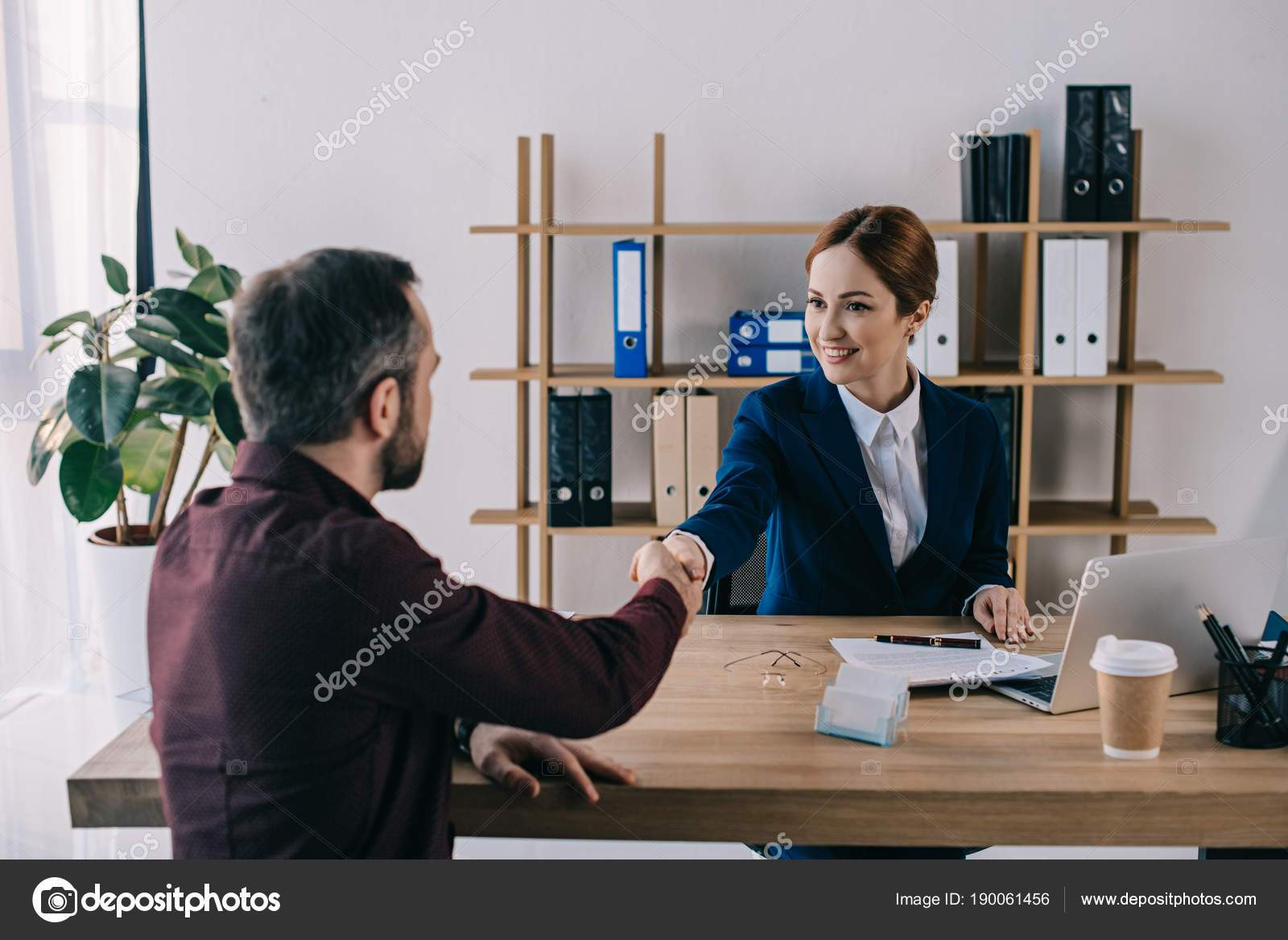 depositphotos_190061456-stock-photo-smiling-businesswoman-client-shaking-hands